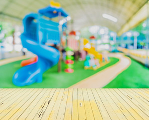 blur image of children's playground at public park