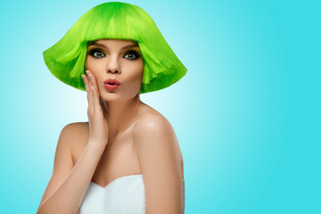 Woman Hair. Fashion Stylish Beauty Portrait With Green Hair. Beautiful Girl's Face Close-up. Haircut. Hairstyle. Fringe. Professional Makeup. Make-up. Vogue Style Woman. Against blue background