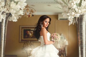 Bride in white wedding dress in luxury place