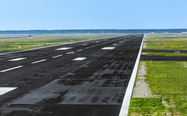 wet runway at airport just before take off
