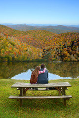 Father and daughter relaxing on a hiking trip.