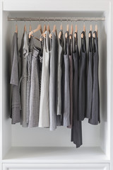 women's dress  and clothes hanging