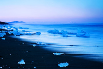 Iceberg on black sand beach of Iceland