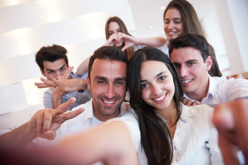 group of friends taking selfie