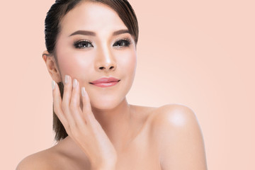 beautiful young asian woman with closed eyes touching her face, Beautiful Spa Perfect Fresh Skin, Youth and Skin Care Concept over pink background with clipping path.