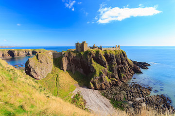 Dunnottar Castle with blue sky in - Stonehaven, Aberdeen, Scotland Wall mural