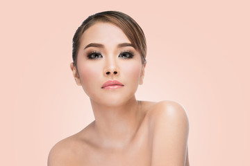 Beauty Asian Woman face Portrait. Beautiful Spa model Girl with Perfect Fresh Clean Skin. looking at camera and smiling. Youth and Skin Care Concept. on pink background with clipping path