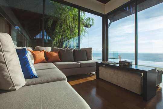 Luxury living room interior with shadow and seascape view
