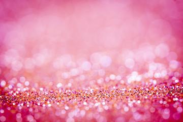 Abstract blur pink  bokeh lighting from glitter texture