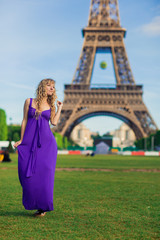 beautiful girl in Paris on a background of the Eiffel Tower