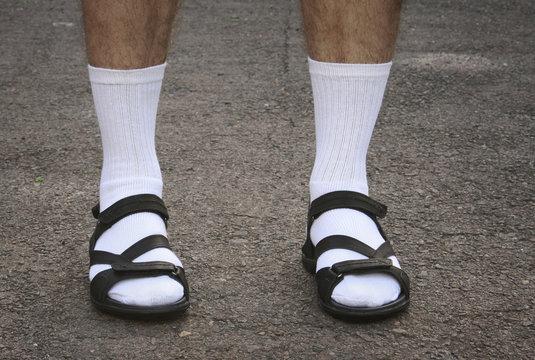 Men's feet in sandals