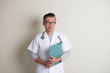 asian senior doctor holding folder