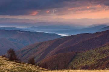 Colorful sunset  in the autumn mountains.