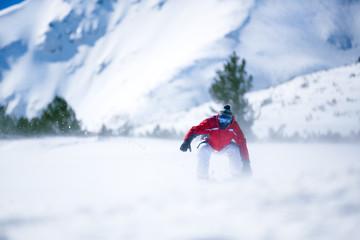 Man snowboarding down hill