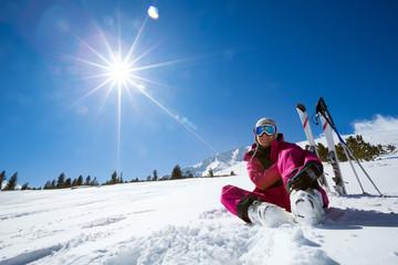 resting female skier in winter resort