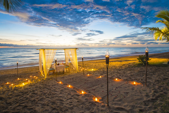 dinner set up on the beach sunset time