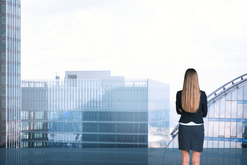 Woman on cityscape background, rear view