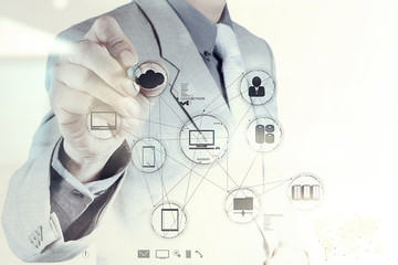 Wall Mural - Businessman hand working with a Cloud Computing diagram