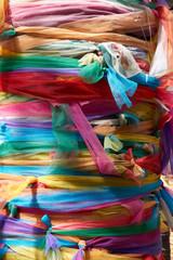 Foto op Plexiglas Paradijsvogel Colorful fabric wrap the tree with faith