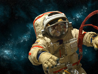 Fototapete - A cosmonaut floats in deep space - Elements of this image furnished by NASA.