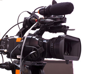 Professional digital video camera. tv camera in a concert hal.