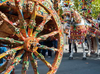 Close up view of a colorful wheel of a typical sicilian cart during a folkloristic show Wall mural
