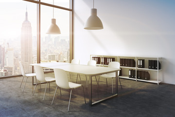 A conference room in a modern panoramic office with New York view. White table, white chairs, a bookcase and two white ceiling lights. 3D rendering. A sunset. Toned image.