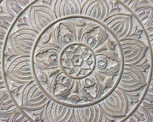 Circular Pattern of a Flower Carved in Stone