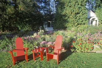 Red deck chairs in garden VT