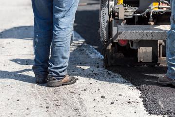 Worker navigating pavement truck