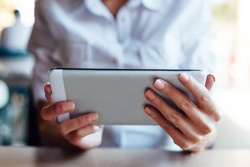 Closeup of woman holding new tablet
