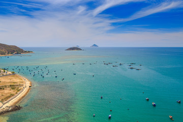upper view of fishing tourist boats in azure sea by coast beach