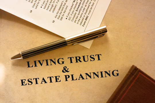 Living trust and estate planning document. A tax form is also included in the scene.