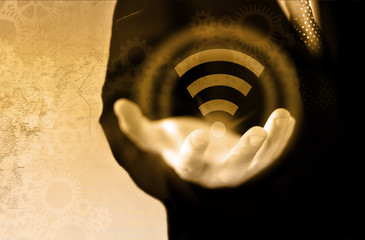 Global communication and technology concept. Wifi symbol in a male hand