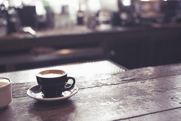 A cup of coffee on counter bar