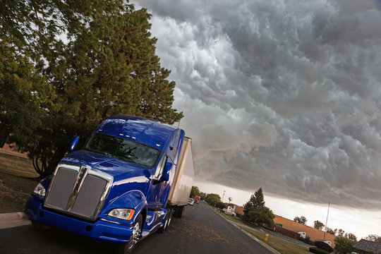 Semi Truck under heavy clouds