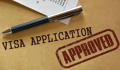 Visa application approved stamp.