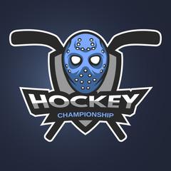 Hockey goalie mask with sticks.