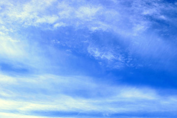 Blue sky with tiny clouds background