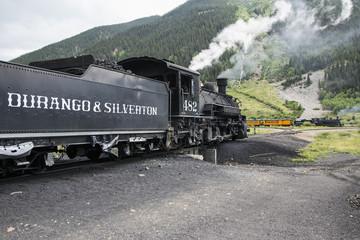 Two trains, Durango and Silverton Narrow Gauge Railroad featuring Steam Engine, Silverton, Colorado, USA, 07.07.2014
