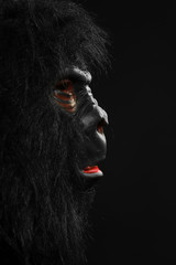 Portrait of a man with gorilla costume isolated on black background