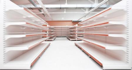Empty supermarket aisle in motion blur