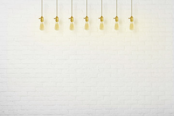 concrete wall and edison classic ceiling lamps