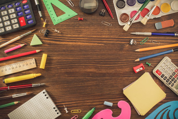 school supplies on wood
