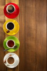 cup of tea, milk, coffee on wood