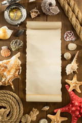 old paper and seashell on wooden background