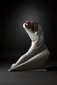 Madness concept. Emotional girl in strange pose