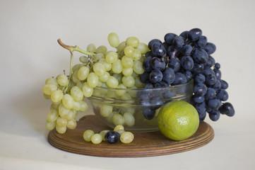 Many fresh fruits on a glassr plate