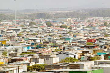 Elevated view of shanty towns or Squatter Camps, also known as bidonvilles, in Cape Town, South Africa