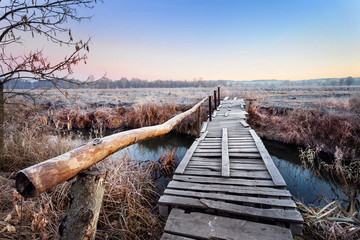 Wooden bridge over river